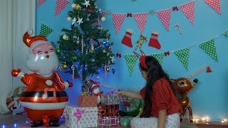 Cute Christian kid decorating her room for Christmas celebration in India