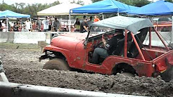 2010 mud bog belen new mexico jeep has a go at it