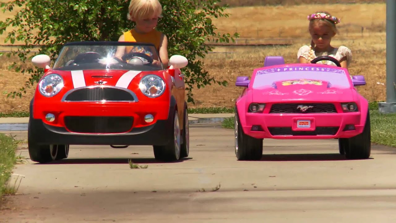 kids ride on car race mini cooper vs disney mustang youtube