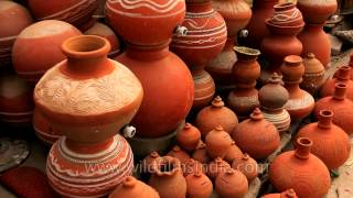 Traditional earthen pots and piggy banks for sale in India