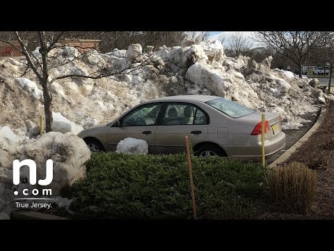 Honda Civic is plowed in by massive snow pile