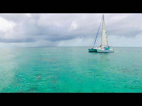 Catamaran motor sailing across a GLASSY Bahama Bank!