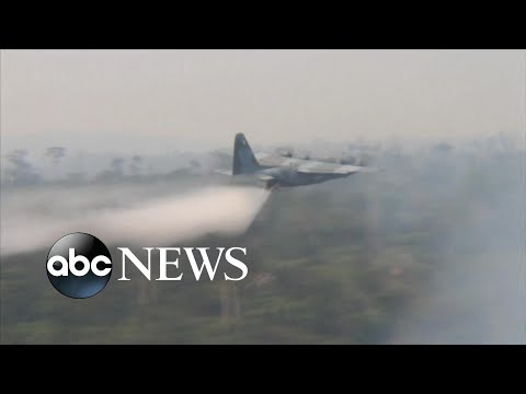 Brazil's air force deployed tankers to drop water on the Amazon as it burns