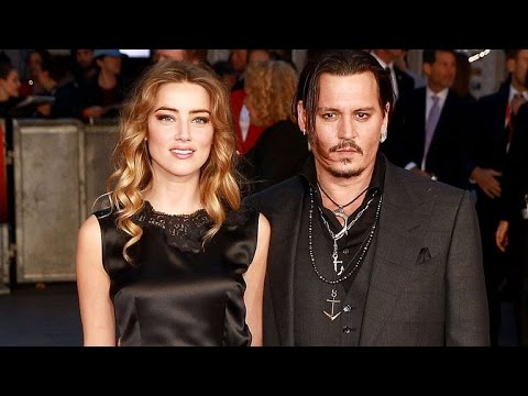 Johnny Depp and Amber Heard Pile on the PDA at Hollywood Film Awards
