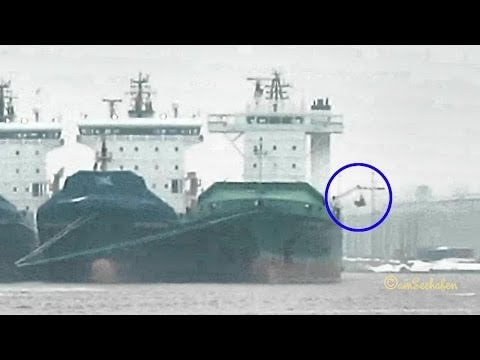 Seamen leaving layup container vessel by safety boat Emden Germany Rettungsboot wird abgeseilt