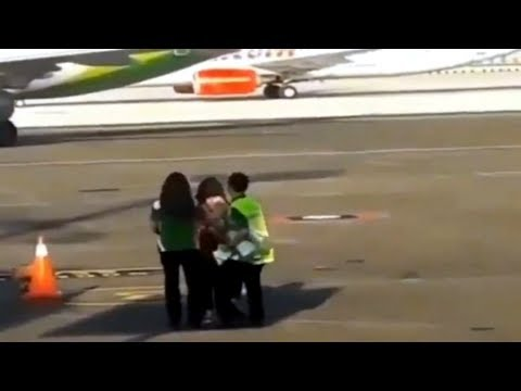 #Viral Video | Woman chases plane on tarmac at Bali airport .