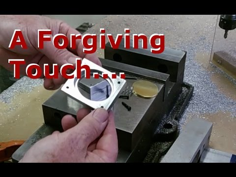 A forgiving Z axis touch plate with spring suspension