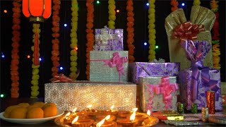 Bokeh shot of Diyas, gifts, sweets, and crackers decorated on the occasion of Diwali festival