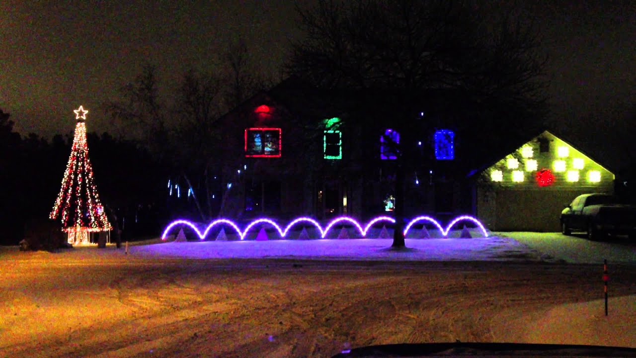 Synchronized Home Alone Christmas Lights & Music show! Merry Christmas from Santa in window ...