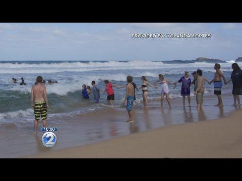 Kauai Beachgoers Form Human Chain To Save Swimmers From Drowning