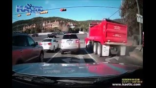 Dump Truck crashes into Car at Red Light