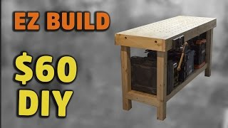 A simple torsion box work bench built from dimensional lumber, plywood, pocket screws and carriage bolts. A torsion box consists of