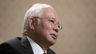 Malaysia former PM Najib and his wife banned from leaving country