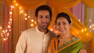 Happy Indian couple facing towards camera - Wearing ethnic traditional dress for a festival
