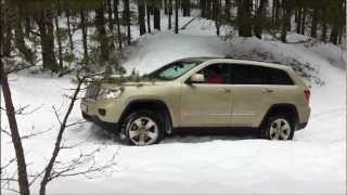 Offroad Grand Cherokee WK2, QuadraTrack II in old snow up-hill