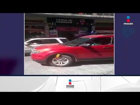 Destroza su auto por no pagar 2 pesos | Noticias con Yuriria Sierra
