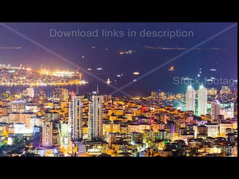 Zoom out timelapse rooftop view of Bosphorus and Istanbul cityscape and Golden horn at night