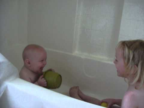 The kiddos playing in the tub