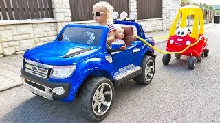 Little Girl Elis Ride On Ford Wildtrak Power Wheel with Cozy Coupe Little Tikes and Dolls Crew