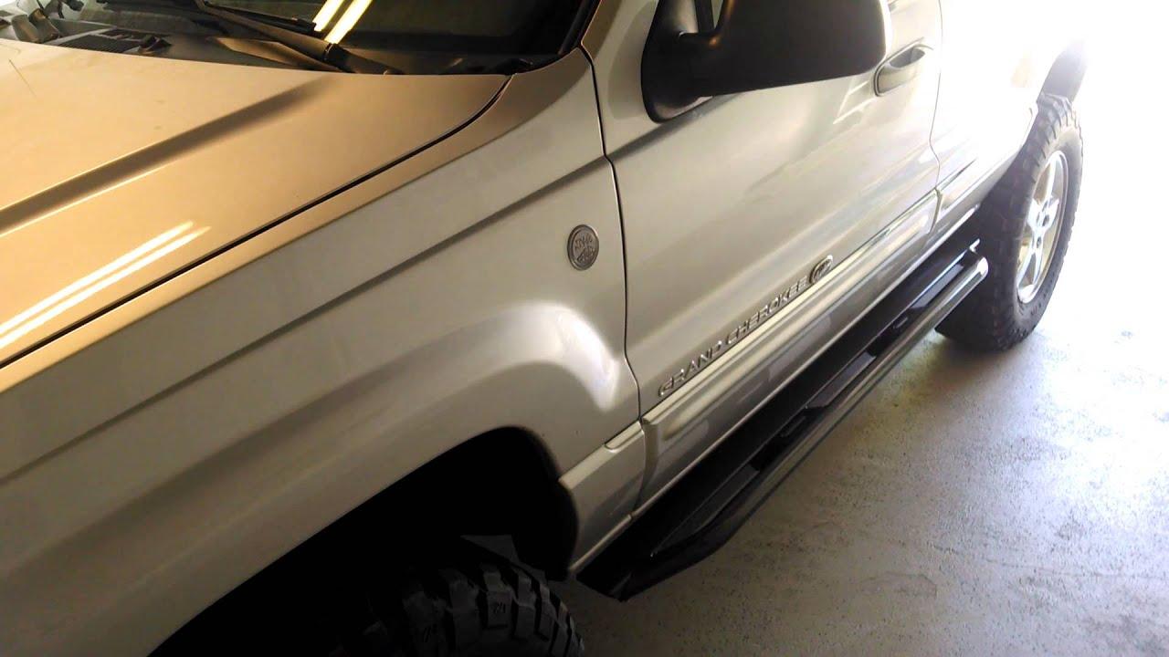 Jeep Grand Cherokee Overland >> JCR rock sliders vs Stock Overland rails 04 WJ - YouTube