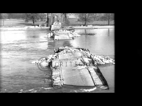 A wrecked bridge over the Rhine River and a dead German soldier on a road in Worm...HD Stock Footage
