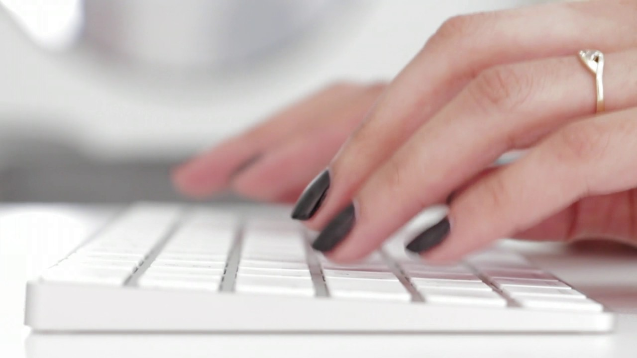 woman s hands typing on a computer keyboard free hd stock footage