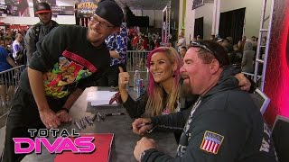 "Natalya and Jim ""The Anvil"" Neidhart sign autographs at Axxess: Total Divas, July 14, 2015"