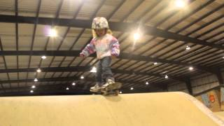 3 year old skater ollies off curbs, drops in quarterpipe, tail stales, rock to fakey & pop shove its