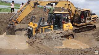 អាប៉ុលធំជាប់ផុងក្នុងខ្សាច់ Big dozer stuck in deep sand - pull out deep stuck by excavator & dozer