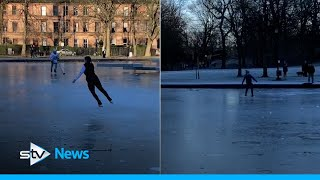 Ice skaters hit frozen boating pond to show off skills