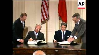 President Ronald Reagan and Soviet Union leader Mikhail S. Gorbachev sign a treaty banning intermedi