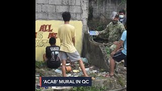 QC cops try to arrest teenage students for painting anti-police mural