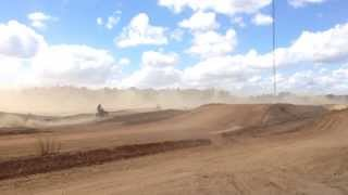 Walsh ltr450 and KFX 450 going around Busco Mx track