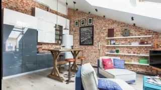 видео Дизайн интерьера квартиры мансардного типа