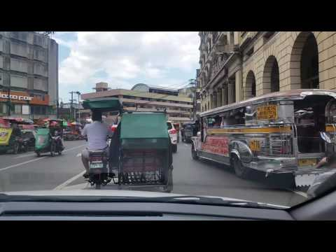 Taxi ride in downtown Manila on Sunday.