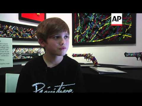 Download Eleven-year-old artist Charles Gitnick has created an exhibit that expresses his feelings about guns