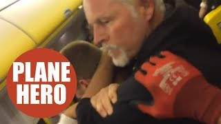 A have-a-go hero put a drunk and aggressive passenger into a chokeh...