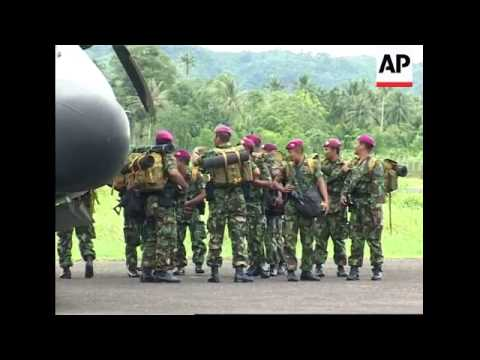 WRAP Military plane arrives, aid unloaded, Oxfam phoner