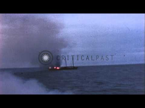 Japanese junk burns after facing attack from USS Tirante (SS-420) in the Pacific ...HD Stock Footage