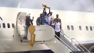 Cavs fans greet the Cleveland Cavaliers as they arrive back home