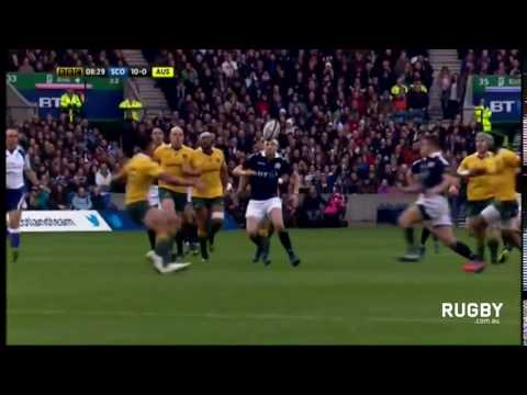 Huw Jones splits the Wallabies defence after chip behind