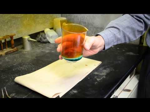Demonstration of a penny in Concentrated Nitric Acid
