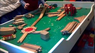 Having Fun Building Wooden Train Track On Train Table