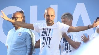 Pep guardiola addresses the crowd at manchester city parade