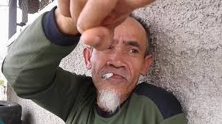 Hussein Sumantri Sejenak Merokok Saat Beristirahat by Kamil Reoga