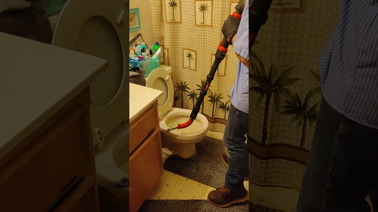 How to unclog a toilet professionally. (How to use a cordless closet auger)