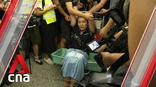 Hong Kong airport protesters tie up man later identified as Global Times reporter