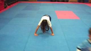 pushup princess in kids karate classes uses combat endurance training