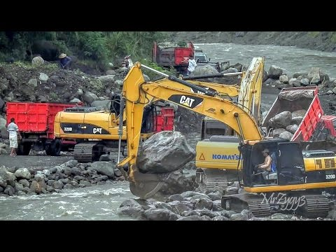 CAT 320D Komatsu PC200 Hyundai 210LC Excavators And Dump Trucks Working Hard On The River