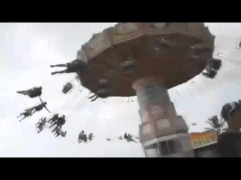 Women falls off Amusement Parks Swing Ride !